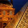 The Louvre Museum in Paris, France, and the metal and glass pyramid which serves as the main entrance to the museum.