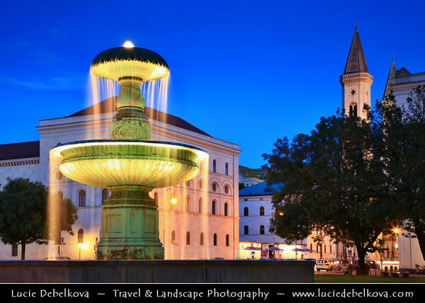 Europe - Germany - Deutschland - Bavaria - Bayern - Munich - München - Illuminated fountain in front of the University - Ludwig Maximilians Universität at Dusk - Twilight - Blue Hour - Night