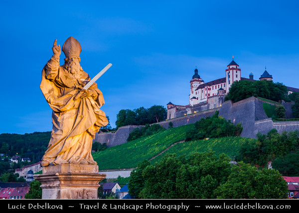 Europe - Germany - Deutschland - Bavaria - Bayern - Franconia - Würzburg - Historic city center - Würzburg's Old Main Bridge - Alte Mainbrücke - One of the most popular landmarks connecting over the river Main the old town with Fortress Marienberg on the hill - Saints' Bridge - Old Stone Bridge with well-known statues of saints