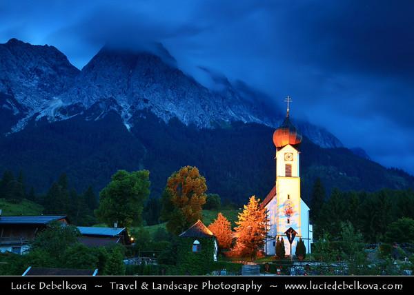 Europe - Germany - Deutschland - Bavaria - Bayern - Garmisch-Partenkirchen District - Grainau located against the Wettersteinmassive & at the foot of the Zugspitze mountain 2,962 m (9,718 ft) above sea level, the tallest mountain in Germany - Grainau Church at Dusk - Twilight - Blue Hour