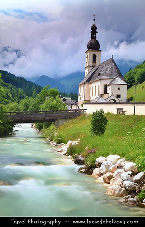 Europe - Germany - Deutschland - Bavaria - Bayern - Berchtesgaden National Park - Ramsau bei Berchtesgaden - Parish Church St. Sebastian with high mountains in the background, including the third highest mountain in Germany, the fabled Mount Watzmann (2713 m)