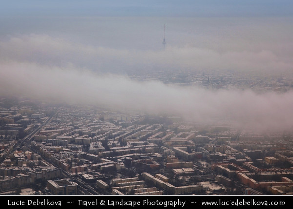 Europe - Germany – Deutschland - Berlin – Capital City - View from above of Television Tower or Fernsehturm in Mitte Berlin - Symbol of Berlin easily visible throughout the central & some suburban districts of Berlin - 368 meters hight making it the tallest structure in Germany during snowy winter<br /> <br /> Camera Model: Canon EOS 5D Mark II; Lens: 24.00 - 105.00 mm; Focal length: 75.00 mm; Aperture: 6.3; Exposure time: 1/80 s; ISO: 100