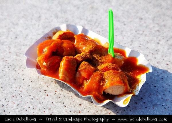 Germany - Berlin - Currywurst at Alexanderplatz - Berlin main meeting point - Currywurst - Popular take-away or street food in Berlin - Steamed, then fried pork sausage - Wurst - seasoned with curry ketchup, regularly consisting of ketchup or tomato paste blended with generous amounts of curry powder<br /> <br /> Camera Model: Canon EOS 5D Mark II; Lens: 24.00 - 105.00 mm; Focal length: 73.00 mm; Aperture: 6.3; Exposure time: 1/200 s; ISO: 100