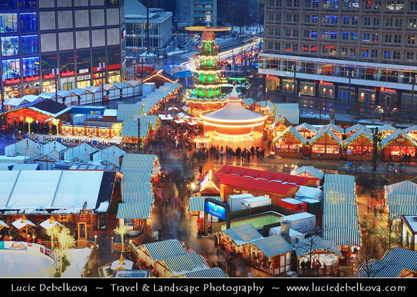 Europe - Germany – Deutschland - Berlin – Capital City - Alexanderplatz -  Public square & transport hub in heart of the central Mitte district, under the iconic TV Tower, near the Fernsehturm - Traditional Christmas Markets<br /> <br /> Camera Model: Canon EOS 5D Mark II; Lens: 24.00 - 105.00 mm; Focal length: 73.00 mm; Aperture: 11; Exposure time: 8.0 s; ISO: 100
