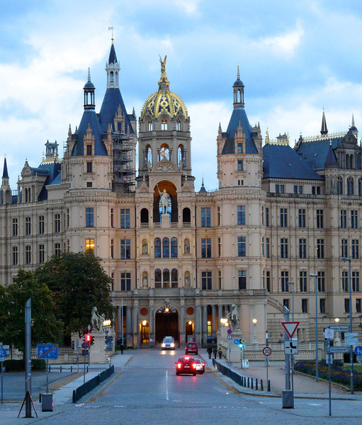 A castle with turrets, a blue roof and gilded gold dome in Germany