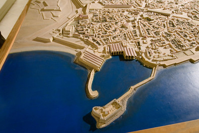 The fortress and harbor were built by the Venetians. The arhed arenals were used to build ships