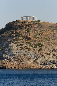 The boat anchored off Akri Sounio for a swim. The temple to Poseidon is on the hill.