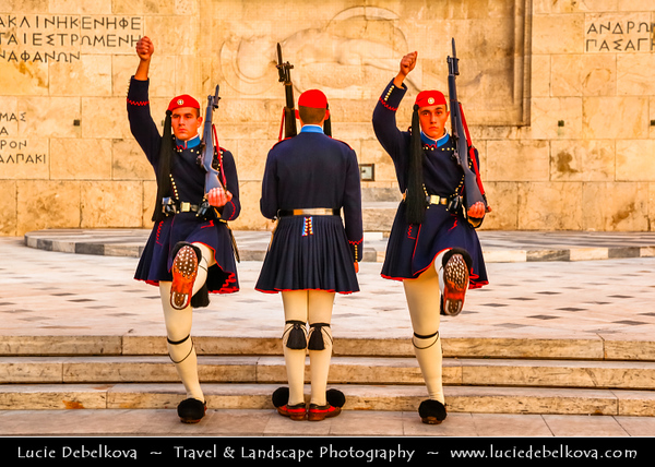 Athens - Αθήνα - Athína - Athine - Capital & largest city of Greece - National Greek guards known as Evzones marching in front of the Parliament building on Syntagma Square / Plateia Syntagmatos