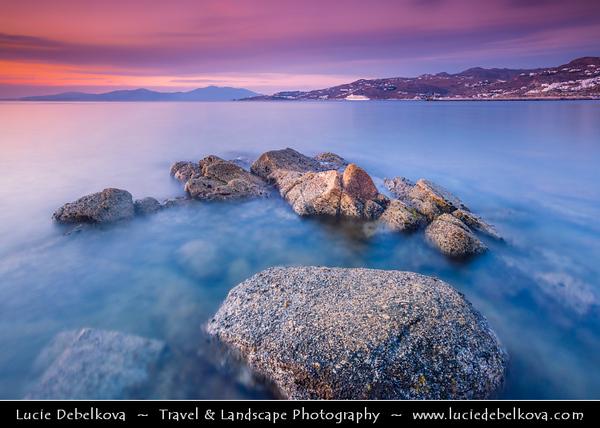 Southern Europe - Greece - South Aegean - Cyclades - Mykonos - Mikonos - Μύκονος - Greek Island in Mediterranean Sea - Chora rocky shore during wonderful evening sunset