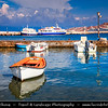 Southern Europe - Greece - South Aegean - Cyclades - Mykonos - Mikonos - Μύκονος - Greek Island in Mediterranean Sea - Chora Harbour with traditional restaurants, stalls with fisherman catch and traditional churches