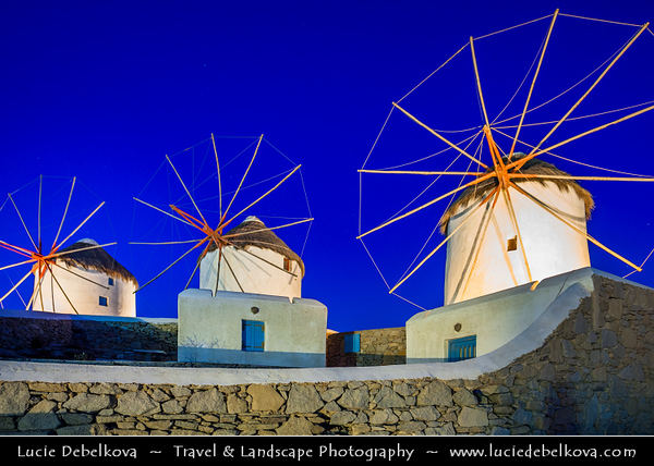 Southern Europe - Greece - South Aegean - Cyclades - Mykonos - Mikonos - Μύκονος - Greek Island in Mediterranean Sea - Chora - Iconic Windmills standing on a hill overlooking area
