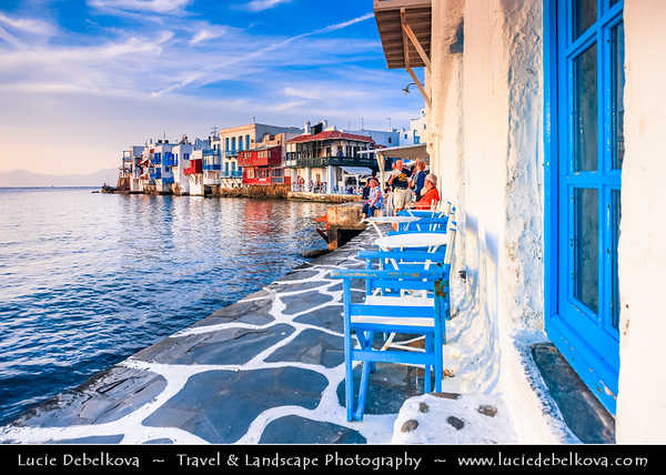 Southern Europe - Greece - South Aegean - Cyclades - Mykonos - Mikonos - Μύκονος - Greek Island in Mediterranean Sea - Chora - Blue-White city of Little Venice - Mikri Venetia - Small part of Chora (on the western edge) with some colorful houses built by the sea with balconies made of wood hanging up above the waves. In the past it was very helpful to be right there so the boats to load/unload the goods fast