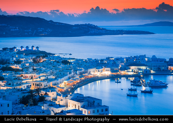 Southern Europe - Greece - South Aegean - Cyclades - Mykonos - Mikonos - Μύκονος - Greek Island in Mediterranean Sea - Chora Harbour with Iconic Windmills standing on a hill overlooking the area