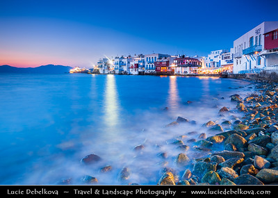 Southern Europe - Greece - South Aegean - Cyclades - Mykonos - Mikonos - Μύκονος - Greek Island in Mediterranean Sea - Chora - Blue-White city of Little Venice - Mikri Venetia - Small part of Chora with some colorful houses built by sea with balconies made of wood hanging up above the waves. In the past it was very helpful to be right there so boats to load/unload goods fast