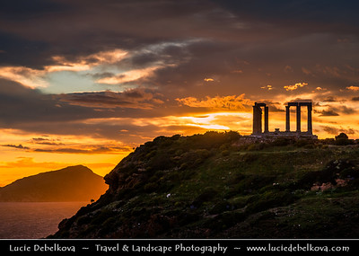 Southern Europe - Greece - Ancient Greek Temple of Poseidon at Cape Sounion - 5th-century BCE temple ruins with Doric-style columns built during 444–440 BC, perched above sea at height of almost 60 metres (200 ft) offering sweeping views of the sea - Spectacular Sunset