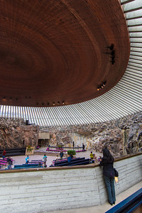 Under the huge copper roof of the Church of the Rock.