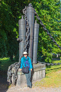 Cannons and chains used to close the strait during Swedish regime are now used to surround the church.
