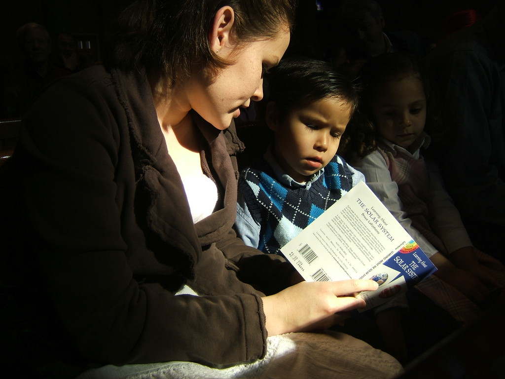 This was taken in the church pew during the service, Annie was showing Jack the solar system book during the 2 hour service, it worked!  The Fuji continues to amaze me...