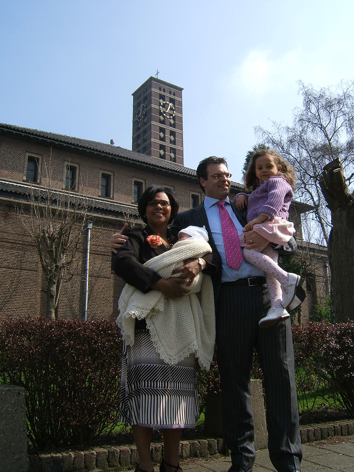 Shelya (mom), Eric (dad), Isabel (daughter) and little Max outside the church after the christening.