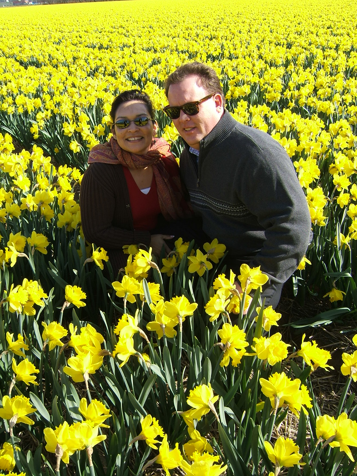 Me and the wife in Lisse, Holland near the Kuekenhof flower exhibit.  This field of daffodils was the only thing up.  Due to a longer than usual winter, the tulips were delayed.