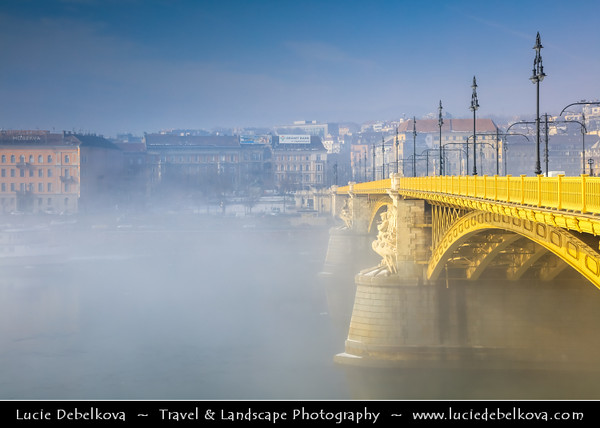 Europe - Hungary - Magyarország - Budapest - Capital City - UNESCO World Heritage Site - Margit Híd - Margaret Bridge - Three-way bridge connecting Buda and Pest across Danube river - Second oldest public bridge in Budapest during magical misty atmosphere