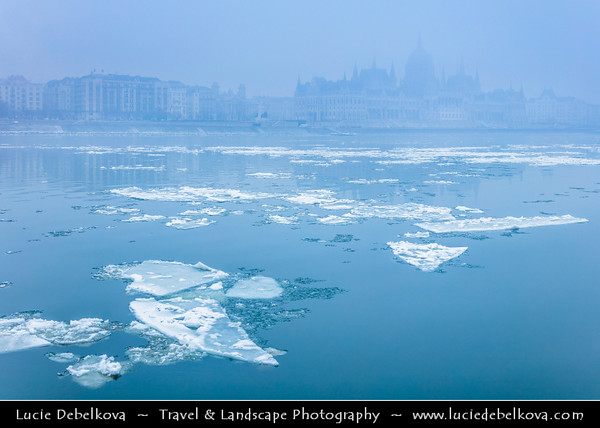 Europe - Hungary - Magyarország - Budapest - Capital City - UNESCO World Heritage Site - Hungarian Parliament Building - Seat of the National Assembly of Hungary on eastern banks of River Danube - Iconic famous Hungarian landmark during winter time with floating ice on Dunaj river