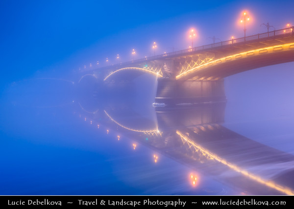 Europe - Hungary - Magyarország - Budapest - Capital City - UNESCO World Heritage Site - Margit Híd - Margaret Bridge - Three-way bridge connecting Buda and Pest across Danube river - Second oldest public bridge in Budapest during magical misty atmosphere - Dusk - Twilight - Blue Hour - Night