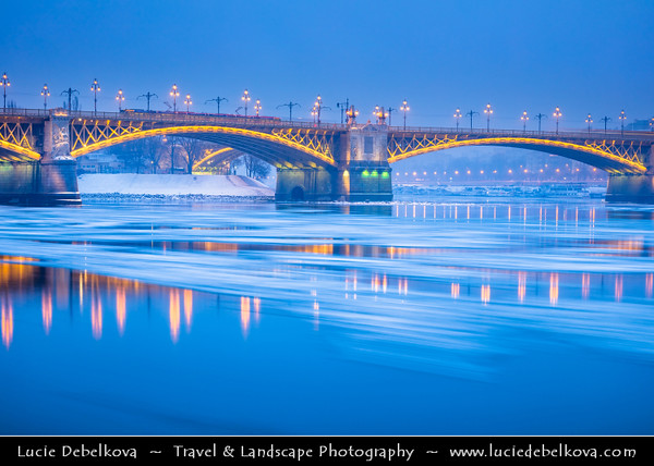 Europe - Hungary - Magyarország - Budapest - Capital City - UNESCO World Heritage Site - Margit Híd - Margaret Bridge - Three-way bridge connecting Buda and Pest across Danube river - Second oldest public bridge in Budapest during winter time with floating ice on Dunaj river
