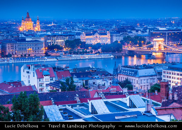 Hungary - Magyarország - Budapest - Capital City - City Panorama - Széchenyi Chain Bridge - Lánchíd - Suspension bridge that spans the River Danube between Buda and Pest, the western and eastern sides of Budapest &  St. Stephen's Basilica - Szent István Bazilika - Roman Catholic Basilica at Night - Twilight - Blue Hour - Dusk
