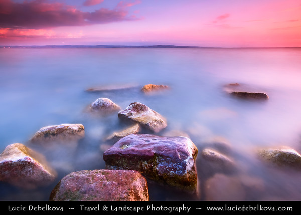 Hungary - Siofok - Lake Balaton - Balcsi - Largest freshwater lake in Central Europe - Beach with Stones during Sunrise