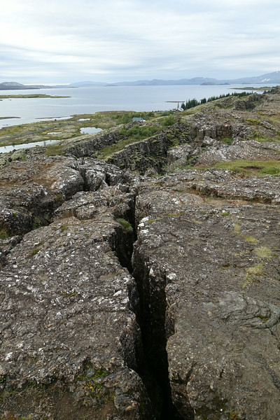 Signs of the Eurasian and North American Plates separating at Þingvellir . The 2 plates are separating at a rate of about 1 inch per year.