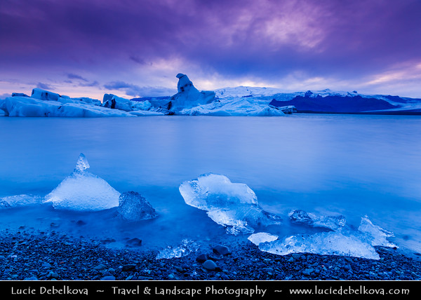 Europe - Iceland - South Eastern Iceland - Jökulsárlón Glacier Lagoon - The largest glacier lagoon at the head of the Breiðamerkurjökull glacier branching from the Vatnajökull - Floating Icebergs at Dramatic Sunset