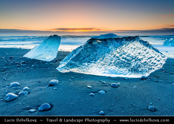 Europe - Iceland - South Eastern Iceland - Jökulsárlón Glacier Lagoon - The largest glacier lagoon at the head of the Breiðamerkurjökull glacier branching from the Vatnajökull - Black Sand beach with Pieces of Ice