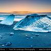 Europe - Iceland - South Eastern Iceland - Jökulsárlón Glacier Lagoon - The largest glacier lagoon at the head of the Breiðamerkurjökull glacier branching from the Vatnajökull - Black Sand beach with Pieces of Ice