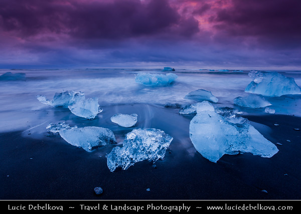 Europe - Iceland - South Eastern Iceland - Jökulsárlón Glacier Lagoon - The largest glacier lagoon at the head of the Breiðamerkurjökull glacier branching from the Vatnajökull - Pieces of Ice on the Black Sand Beach on shores of Atlantic Ocean - Dawn - Twilight - Blue Hour