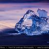 Europe - Iceland - South Eastern Iceland - Jökulsárlón Glacier Lagoon - The largest glacier lagoon at the head of the Breiðamerkurjökull glacier branching from the Vatnajökull - Pieces of Ice on the Black Sand Beach on shores of Atlantic Ocean - Sunrise