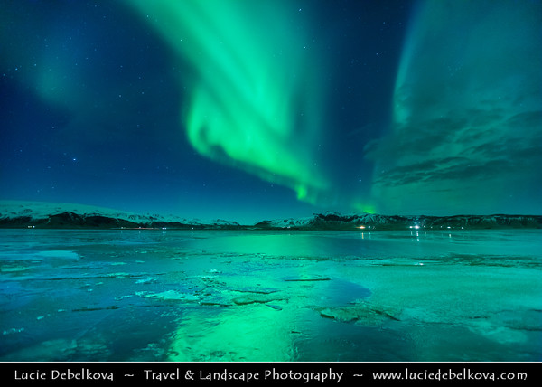 Europe - Iceland - South Iceland - Vík í Mýrdal during Northern lights, also known as Aurora Borealis produced by solar wind particles guided by Earth's field lines to the top of the atmosphere