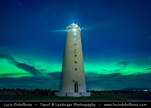 Europe - Iceland - Reykjavik - The Capital City - Seltjarnarnes - Gróttuviti - Grotta Lighthouse under Northern lights, also known as Aurora Borealis produced by solar wind particles guided by Earth's field lines to the top of the atmosphere