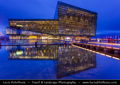 """Europe - Iceland - Reykjavik - The Capital City - Íslenska Óperan - Icelandic Opera House - Downtown Reykjavik beautifully situated next to the water - The exterior wall of the opera house is a double wall of glass """"cells"""" - Dusk - Twilight - Blue Hour"""