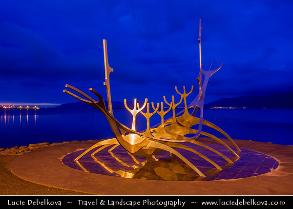 Europe - Iceland - Reykjavik - The Capital City - Solfar - Sun Voyage - Sculpture of a Viking Ship - Sleek contemporary portrayal of a Viking-age ship made of shiny silver steel beautifully situated next to the water - Dusk - Twilight - Blue Hour - Night