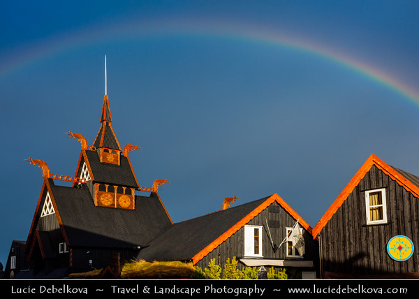 Europe - Iceland - Reykjavik - The Capital City - Hafnarfjörður - Viking Hotel & Restaurant - Traditinal Scandinavian style architecture during dramatic storm with rainbow