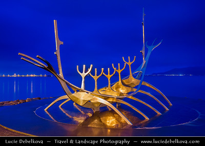 Europe - Iceland - Reykjavik - The Capital City - Solfar - Sun Voyage - Sculpture of a Viking Ship - Sleek contemporary portrayal of a Viking-age ship made of shiny silver steel  beautifully situated next to the water - Dusk - Twilight - Blue Hour