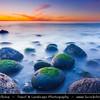 Europe - Iceland - Reykjavik - Hafnarfjörður - Atlantic Ocean beach with round boulders at sunset