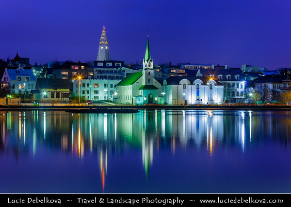 Iceland - Reykjavík - Tjornin - Small pond in central Reykjavik with its well-known landmarks -  Hallgrimskirkja & The tin clad Frikirkjan i Reykjavik church at Dusk - Twilight - Blue Hour