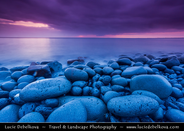 Europe - Iceland - Reykjavik - The Capital City - Hafnarfjörður - Volcanic pebbles beach captured during dramatic stormy sunset