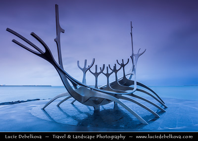 Europe - Iceland - Reykjavik - The Capital City - Solfar - Sun Voyage - Sculpture of a Viking Ship - Sleek contemporary portrayal of a Viking-age ship made of shiny silver steel  beautifully situated next to the water - Stormy Evening