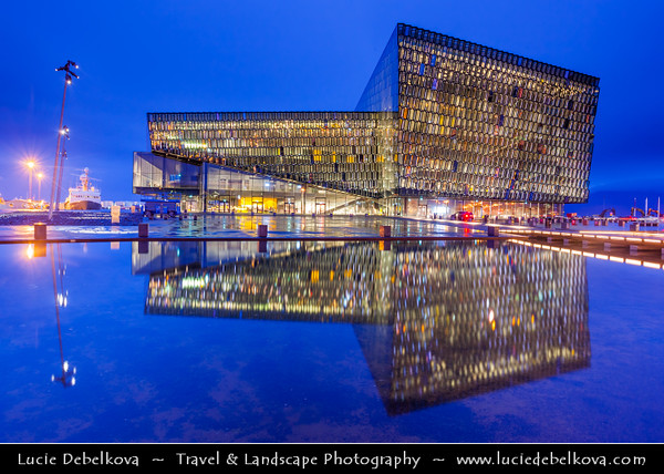 "Europe - Iceland - Reykjavik - The Capital City - Íslenska Óperan - Icelandic Opera House - Downtown Reykjavik beautifully situated next to the water - The exterior wall of the opera house is a double wall of glass ""cells"" - Dusk - Twilight - Blue Hour"