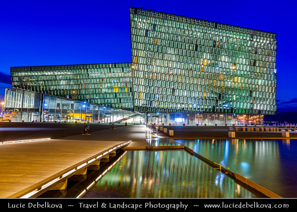 Iceland - Reykjavík - Harpa Concert Hall & Conference Center - Reykjavik's dazzling new concert situated on the border between land and sea - Concert Hall stands out as large, radiant sculpture reflecting both sky & harbour space at Dusk - Twilight - Blue Hour