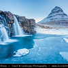 Europe - Iceland - West Iceland - Snæfell Peninsula - Snæfellsnes - Grundarfjörður - Grundarfjordur - Kirkjufell - Church Mountain (463 meters) - Iceland's most iconic pyramid shaped mountain standing isolated along the Atlantic Ocean coast - Seen from the Kirkjufellsfoss waterfall during winter time under fresh snow cover