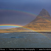 Europe - Iceland - Snæfell Peninsula - Snæfellsnes - Grundarfjörður - Kirkjufell - Church Mountain (463 meters) - Iceland's most iconic pyramid shaped mountain stands isolated along the cost, this axe blade shaped mountain is seen for miles - Captured during incredibly strong wind & rain with the most intensive rainbow over it